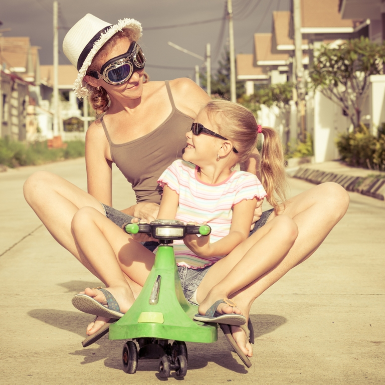 Mum and daughter on a bike