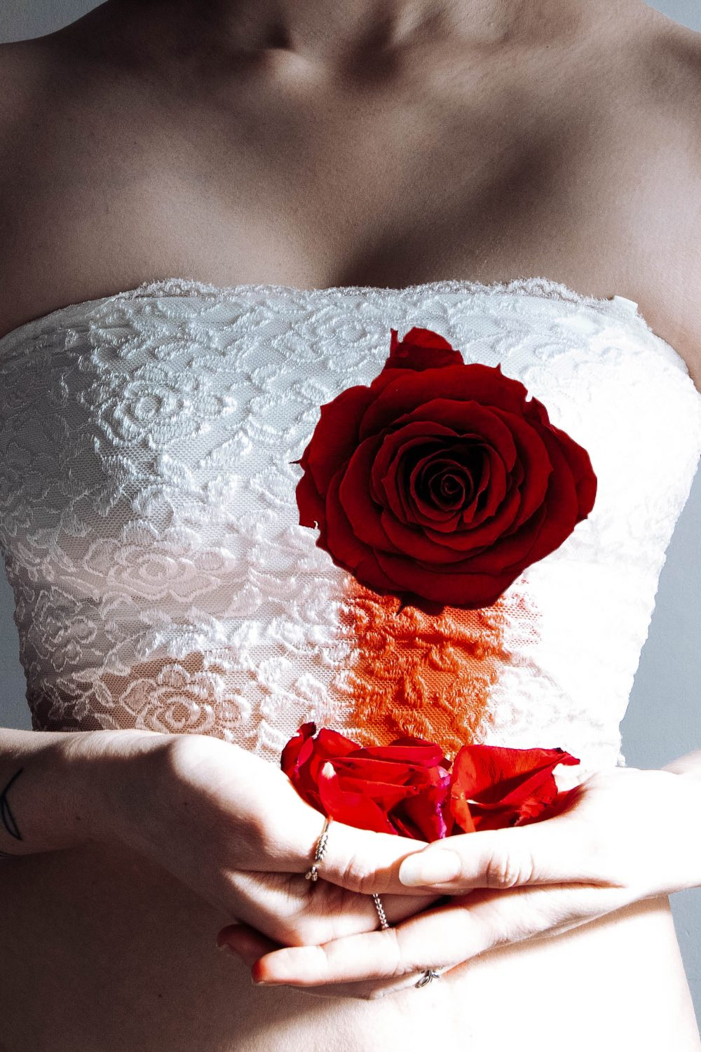 girl with rose as a heart that is beeding