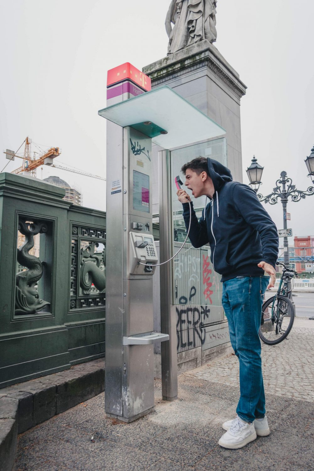 Man shouting into a telephone box