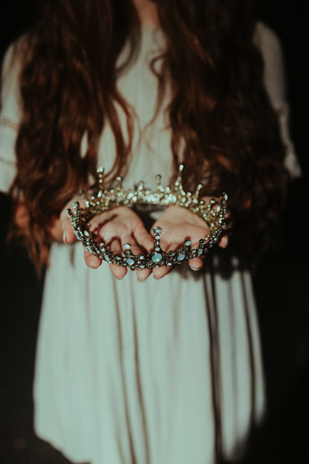girl holding crown in article talkign about Tiara Syndrome